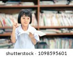 blurry happy child girl holding ... | Shutterstock . vector #1098595601