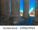 Stock photo april washington d c columns of supreme court offers view of us capitol 1098625964