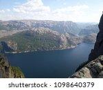 the norwegian fjord lyusebotn ... | Shutterstock . vector #1098640379