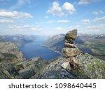 the norwegian fjord lyusebotn ... | Shutterstock . vector #1098640445