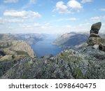 the norwegian fjord lyusebotn ... | Shutterstock . vector #1098640475