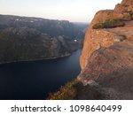 the norwegian fjord lyusebotn ... | Shutterstock . vector #1098640499