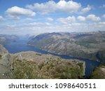 the norwegian fjord lyusebotn ... | Shutterstock . vector #1098640511