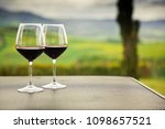 two glasses of red wine against ... | Shutterstock . vector #1098657521