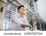 joyful man enjoying life in... | Shutterstock . vector #1098700724