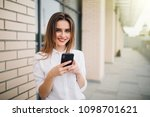 young woman use mobile phone in ... | Shutterstock . vector #1098701621