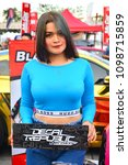 Small photo of PASIG, PH-MAY 13: Decal Republic by Chuck female model on May 13, 2018 in Pasig, Philippines. Hot Import Nights is an auto show featuring compact and tuner import cars.