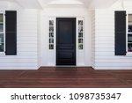 Black Front Door Of Classic...