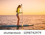 sporty young woman at stand up...   Shutterstock . vector #1098742979