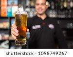 men hold glass of beer | Shutterstock . vector #1098749267