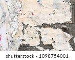 street poster residue on brick... | Shutterstock . vector #1098754001