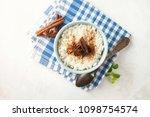 rice porridge with cinnamon in... | Shutterstock . vector #1098754574