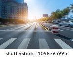 empty road with zebra crossing... | Shutterstock . vector #1098765995