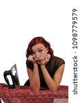 beautiful woman holding a...   Shutterstock . vector #1098779579