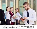 a young male manager with a... | Shutterstock . vector #1098790721