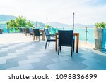 empty patio chair and table... | Shutterstock . vector #1098836699