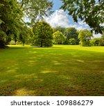 a green lawn in the park summer ... | Shutterstock . vector #109886279