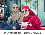 two arab ladies wearing modern... | Shutterstock . vector #1098875321