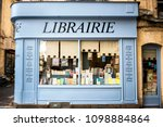 Small photo of REIMS – CHAMPAGNE - FRANCE. AUGUST 17, 2017: Bookshop with wooden facade of ancient books with a retro charm. France.