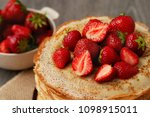 thin pancakes with strawberries.... | Shutterstock . vector #1098915011