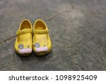 pair of yellow shoes | Shutterstock . vector #1098925409