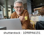 trendy middle aged man drinking ...   Shutterstock . vector #1098946151