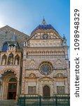Small photo of Part of facade from Basilica of Santa Maria Maggiore, Cappella Coleoni, Piazza Duomo, Bergamo Alta Citta, Italy. Romanesque architecture with a gilded interior hung with tapestries, built in 1137.