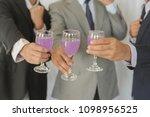 business group cheers  wine... | Shutterstock . vector #1098956525