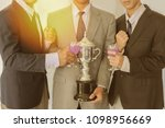 business group cheers  wine... | Shutterstock . vector #1098956669