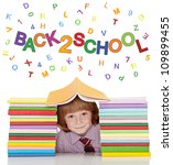 Small school boy with shirt and tie and lots of books having fun - isolated - stock photo
