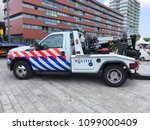 Small photo of Almere, Netherlands - May 26, 2018: Dutch National Police Tow or Repo Truck Ford Jerr Dan parked by the side of the road.