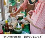 hands of small noodle shop... | Shutterstock . vector #1099011785