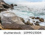 waves break on the quayside at...   Shutterstock . vector #1099015004