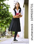 Small photo of Goofy Girl Student Wearing Skirt