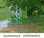 river emerald as green as a... | Shutterstock . vector #1099064021