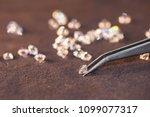 diamond with tweezers and... | Shutterstock . vector #1099077317