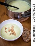 zucchini soup with gorgonzola... | Shutterstock . vector #1099078295