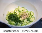 cucumber salat with dill and... | Shutterstock . vector #1099078301