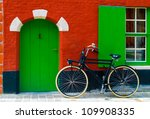 Colorful House With A Bike Nea...