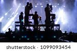silhouette group of cameramen... | Shutterstock . vector #1099093454