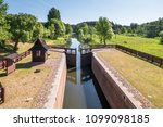 Small photo of gateway lock sluice drawbridge construction on river, canal for passing vessels at different water levels