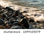 waves hit to the stones on the... | Shutterstock . vector #1099105079