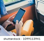 woman using mobile smartphone... | Shutterstock . vector #1099113941