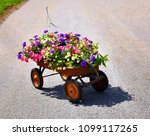 wagon filled with flowers | Shutterstock . vector #1099117265