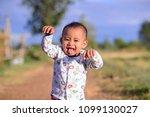 little boy showing tongue. | Shutterstock . vector #1099130027