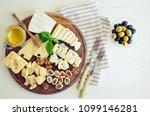 cheese platter  parmesan ... | Shutterstock . vector #1099146281