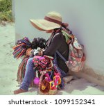 woman sales souvenirs on a... | Shutterstock . vector #1099152341
