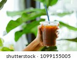 black coffee on the hand | Shutterstock . vector #1099155005