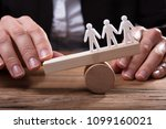 businessperson placing finger... | Shutterstock . vector #1099160021