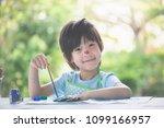 cute asian child enjoying arts... | Shutterstock . vector #1099166957
